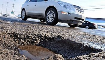 Pothole damage driving coil spring repairs