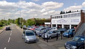 Man attacked dealership with axe