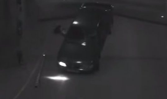 Video: Bizarre car park exit leaves car on roof
