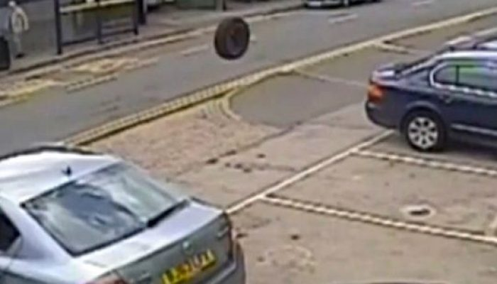 Video: Mechanics lucky escape from runaway wheel