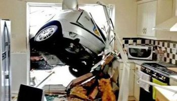 Pensioner escapes injury after Focus smashes into kitchen