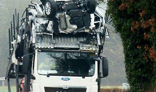 Wedged car transporter flattens brand new Fords