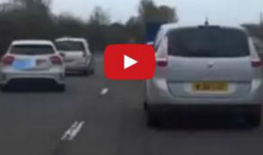 Video: Motorist deliberately blocks car from cutting in