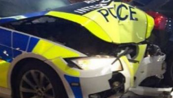 Police car crashes into petrol station