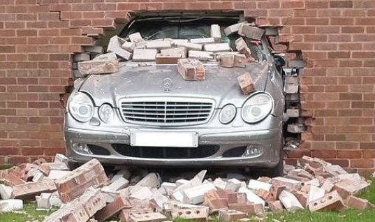 Mechanic crashes Mercedes into garage wall