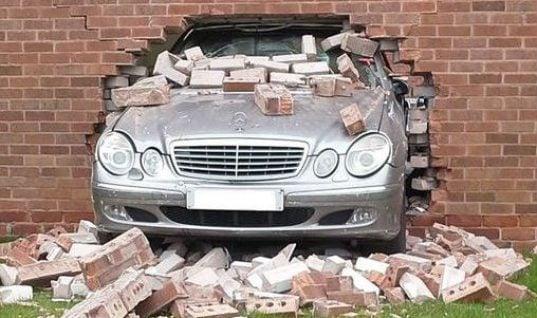 Mechanic crashes Mercedes into garage wall