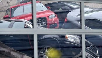 20 cars plunge through Audi dealership as first floor collapses