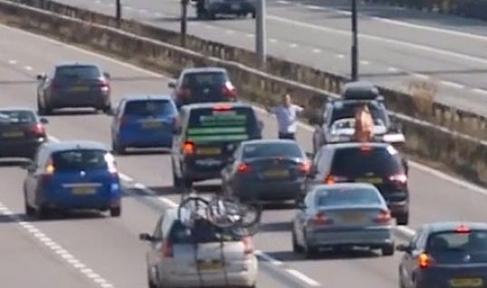 Video: barefoot driver gets out to stop M4 traffic