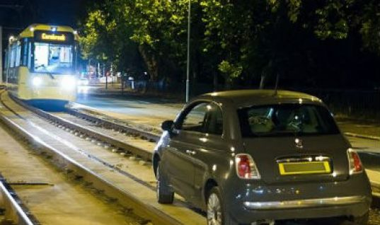 Chaos as motorist approaches oncoming tram and gets stuck