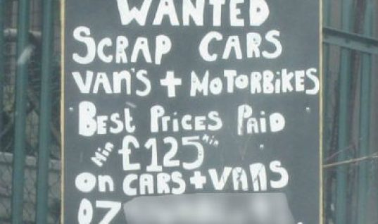 Garage denies running illegal scrap yard while stood next to this sign