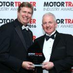 IGA Director ,Stuart James (left) presents the award to Graham Clark.
