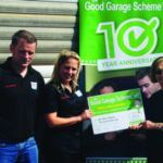 Sean Regan, manager, and Natalie Morton-Boyce, director of Good Garage Scheme member S&B Motors, present feedback prize winner Muriel Rapport with a cheque for £200.