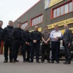 Colin Chatburn, account manager at Klarius Products Ltd, presents Merityre Specialists Ltd director Dene Arnold and his team of vehicle technicians with their IMI training certificates at the Merityre in Andover.
