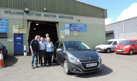 AutoCare garage presents customer with brand new Peugeot 208
