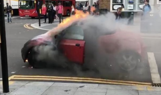 Watch: drama as burning car rolls down busy London street