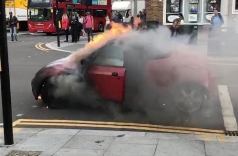 Watch: drama as burning car rolls down busy London street