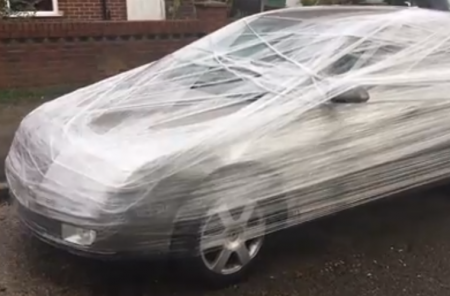 Video: frustrated man cling-films car parked outside his house