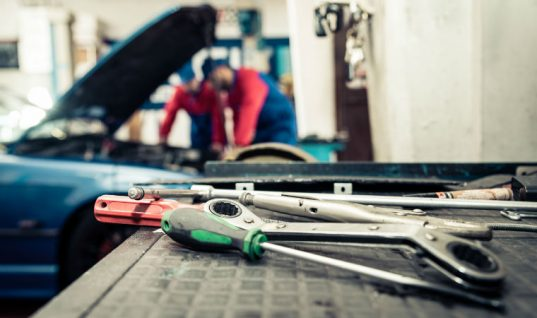 """""""Don't worry about stereotypes"""" female mechanic urging women into the workshop"""
