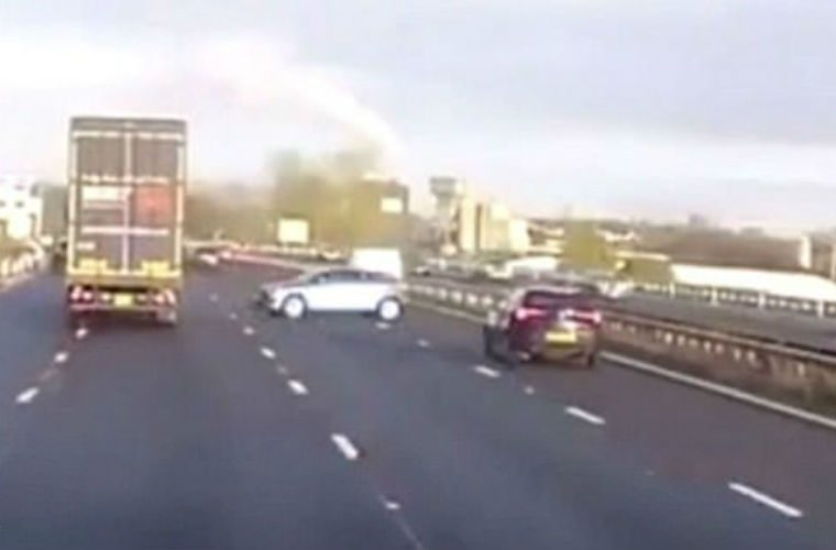 Terrifying moment HGV clips car and sends it spinning across four lanes