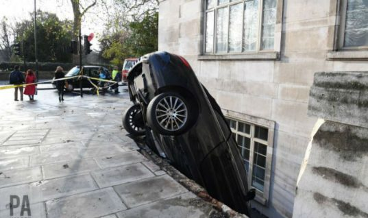 Onlookers queue to snap wedged Mercedes