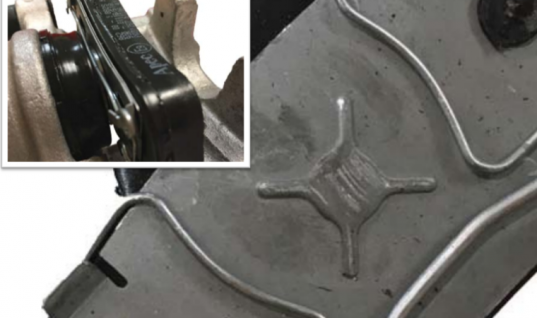 Brake pad wire clamp warning for technicians