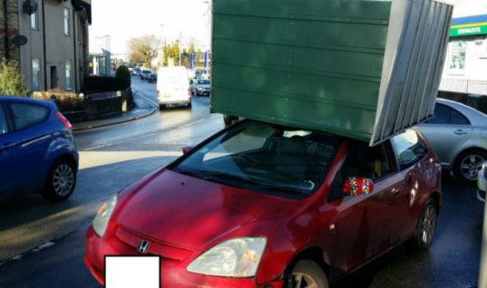 Motorists warned of overhanging loads after driver balances shed on roof