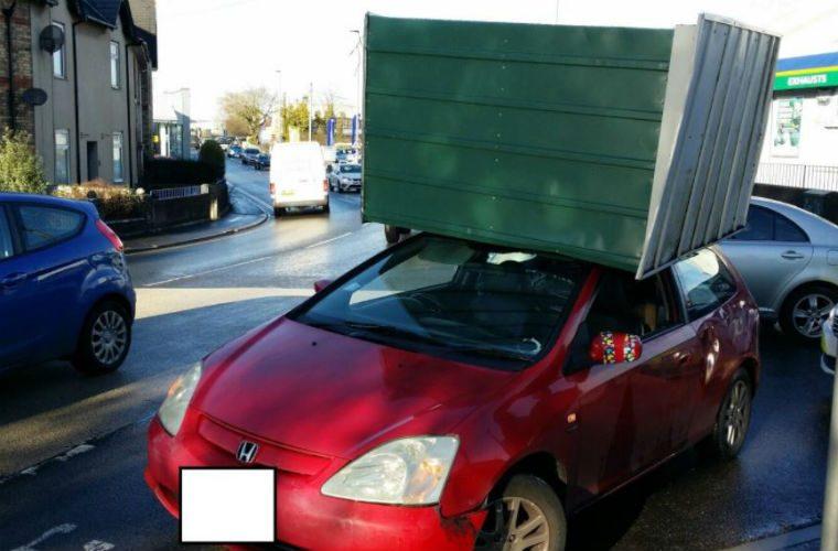 Motorists warned of overhanging loads after driver balances shed on roof