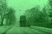Watch: Skilled bus driver drifts double decker around snow-stricken car to avoid collision