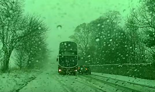 Watch: Skilled bus driver drifts double decker around snow-stricken car to avoid collision