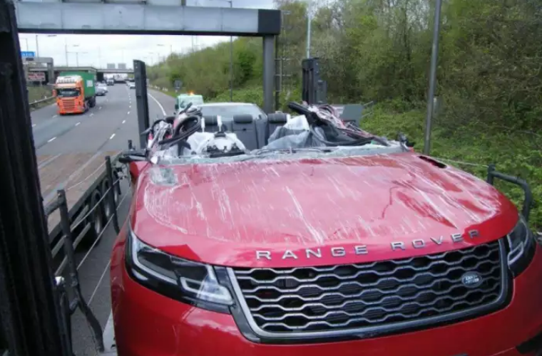 Brand new Range Rover has its roof ripped off when transporter hit M61 bridge