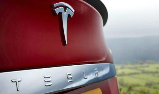 Tesla reports record £523M loss