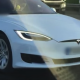 Tesla driver gets banned after getting caught in passenger seat with autopilot engaged
