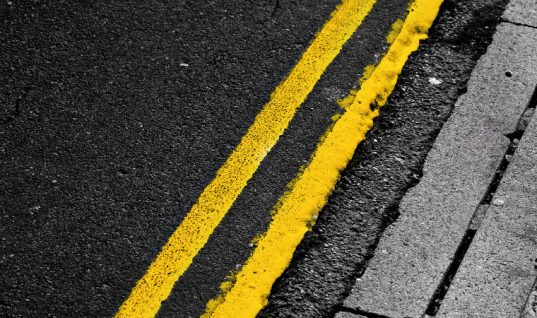 Resident refuses to move his car and let council paint yellow lines outside his home