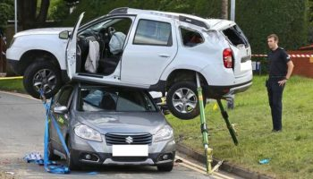 Bizarre crash leaves car left balancing on top of another