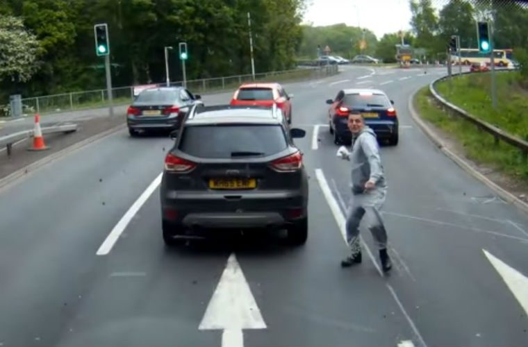Watch: Furious driver stops in live lane to throw milk at another driver