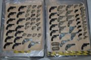 Police seize arsenal of 90 guns hidden in engines