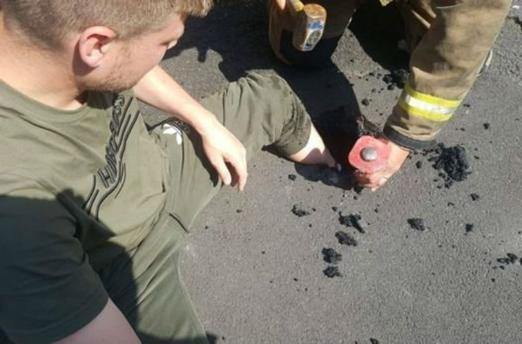 Man rescued by firefighters after sinking into melting road