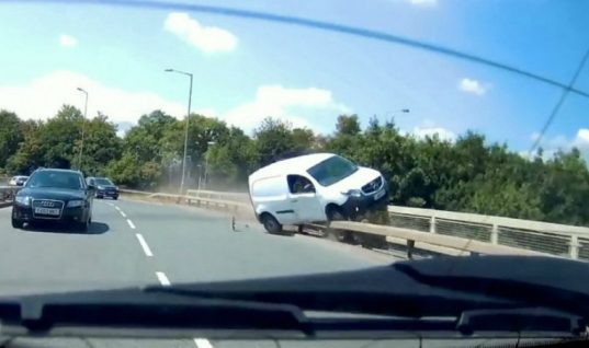 Watch: Shocking see-it-to-believe-it moment driver almost runs van off bridge
