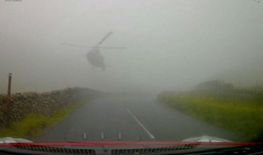 Watch: SAS helicopter swoops down through fog narrowly missing motorists