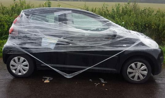 Residents near Bristol Airport wrap holidaymaker's car in clingfilm and 'egg it'