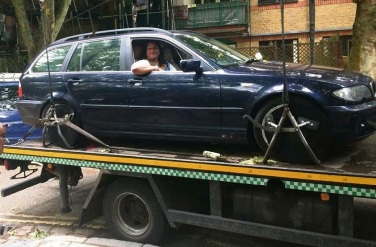 Woman refuses to move from car while on tow truck and wins parking dispute