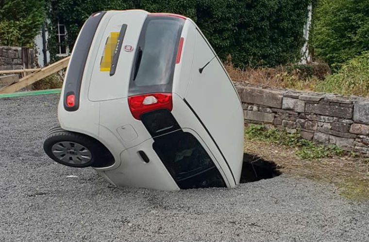 Video: Sinkhole swallows Fiat Panda at Welsh castle