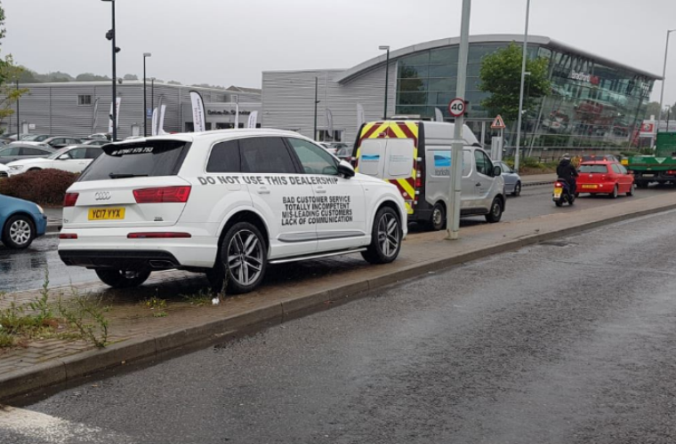 Audi Q7 owner covers car with complaints in protest of sister-in-law's A6 repair quote