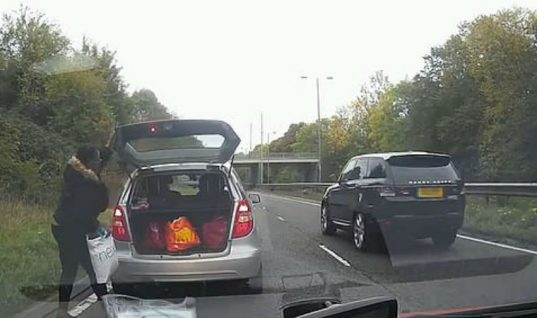 "Watch: Motorist ""nearly causes pile up"" by stopping on carriageway to get bag from boot"