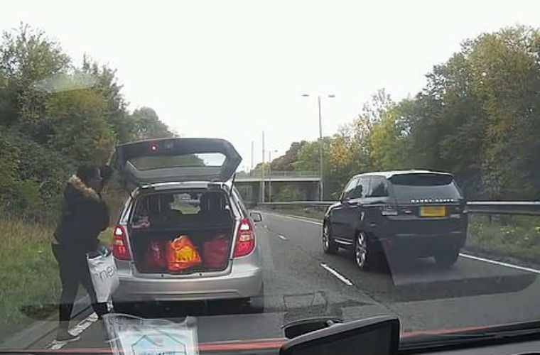 """Watch: Motorist """"nearly causes pile up"""" by stopping on carriageway to get bag from boot"""