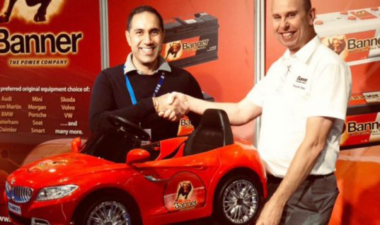 Two Banner winners drive off with kids' electric car at AAG trade show