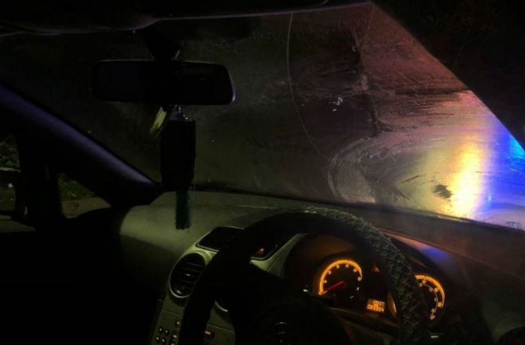 Motorist with iced windscreen almost collides head-on into police car