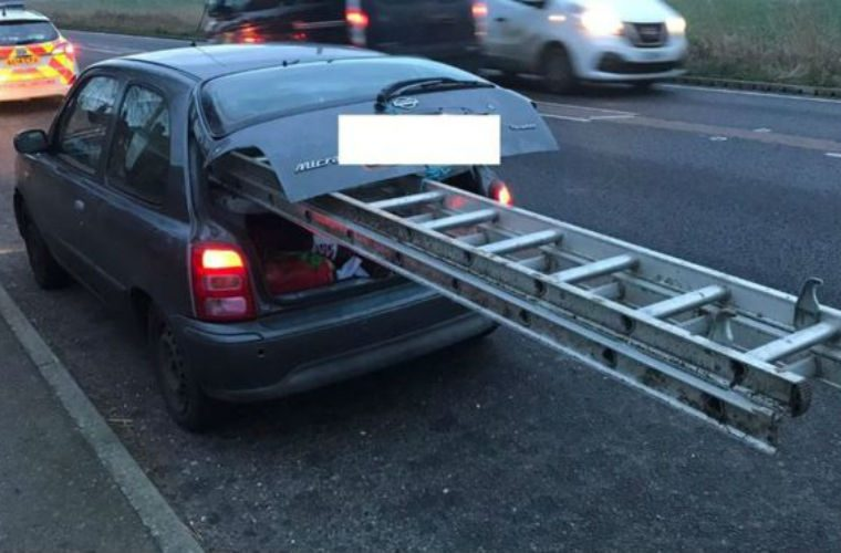 Police stop Nissan Micra with large ladder hanging out boot