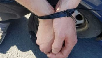 Motorist caught driving with hands-tied gets banned from road