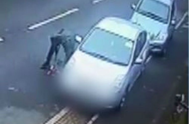 Watch: Thieves caught on camera jacking up parked car as they steal catalytic converter